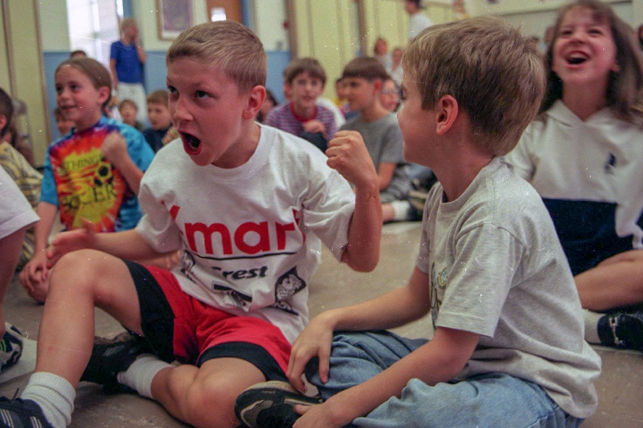 Steven Vasil (L), 8, decided to play air guitar along with performer Les Julian at North Center School in Southington. Steven