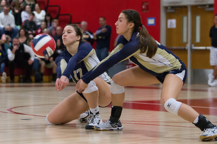 Power in numbers: Platt teammates Gabriela Vazquez (left) and Jenixza Febles get in position to receive a RHAM serve Saturday during the CIAC Class L state final at Berlin High School. | Justin Weekes / For the Record-Journal