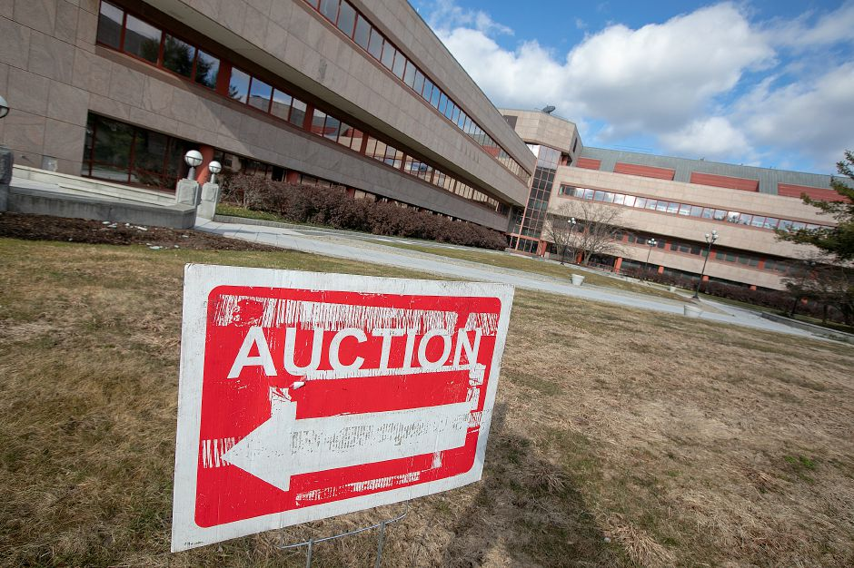 Auction sign placed on the lawn of the former Bristol-Myers Squibb in Wallingford, Fri., Jan. 25, 2019. Dave Zajac, Record-Journal
