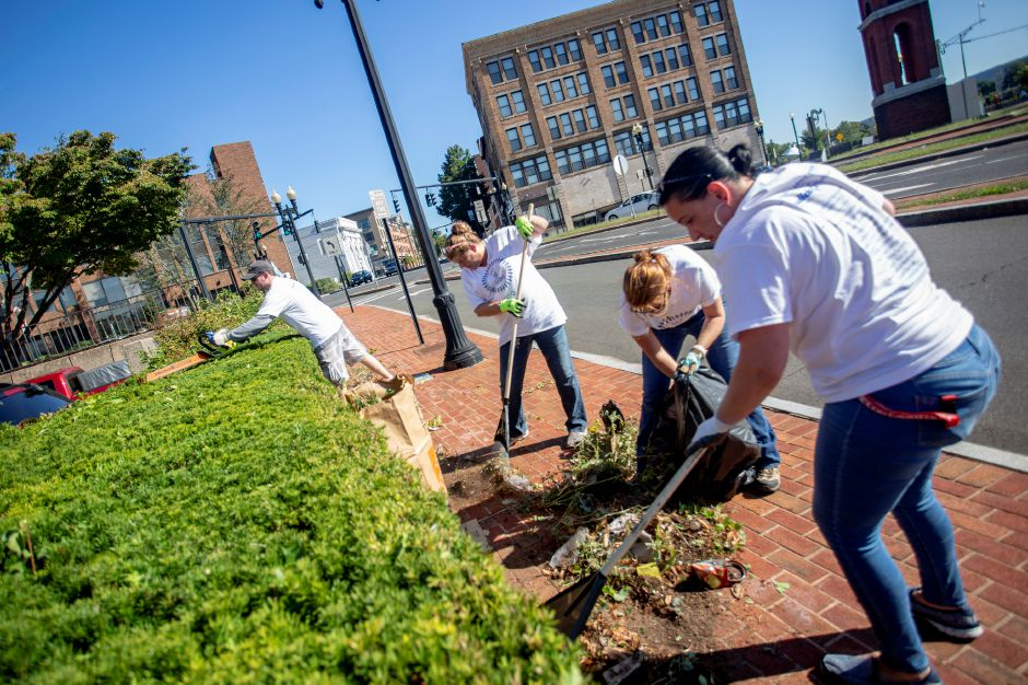 From left, Dave Mazzacaro, Dundee Benson, Courtney Wengenroth and Rehekah Larsen from the Record-Journal spruce up the hedges by the Meriden Y Arts Center Sept. 27, 2019 as part of the United Way Day of Caring. | Richie Rathsack, Record-Journal