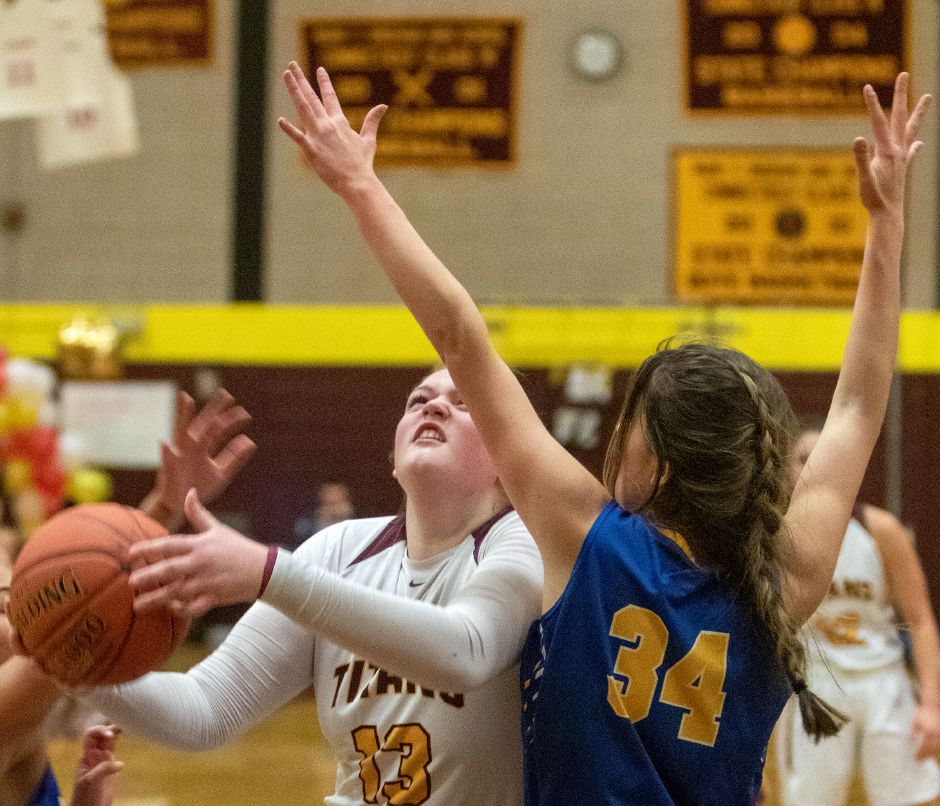 Sheehan's Caitlyn Hunt gets around Mercy's Samantha Strell as she gets fouled going to the basket during the first half at Sheehan High School on Friday, February 14, 2020. Aaron Flaum, Record-Journal