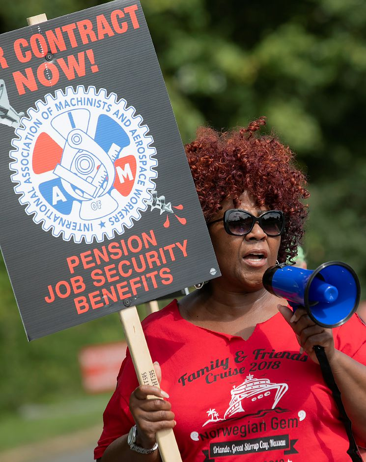 Gail Byrd-Fox, of Wolcott, leads a chant as employees of UTC Aerospace Systems walk the picket line during a strike in front of the business on Knotter Drive in Cheshire, Monday, Sept. 17, 2018. Byrd-Fox has worked at the business for 44 years. Dave Zajac, Record-Journal
