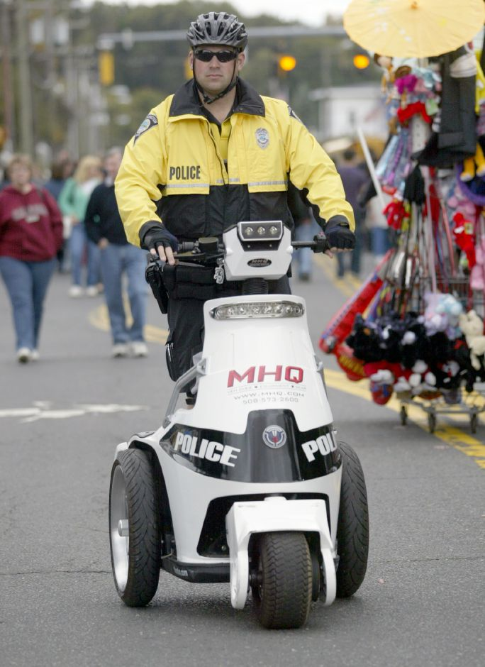 SOUTHINGTON, Connecticut - Saturday, October 10, 2009 - Southington Police Officer Michael Kahn patrols Main Street during the Apple Harvest Festival riding a T3 Motion Series ESV Law Enforcement Electric Vehicle on Saturday, October 10. Rob Beecher / Record-Journal