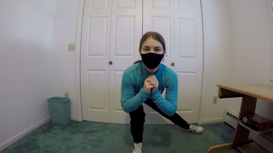 Kristen Dearborn demonstrates workouts while wearing a mask. |Kristen Dearborn, special to Record-Journal