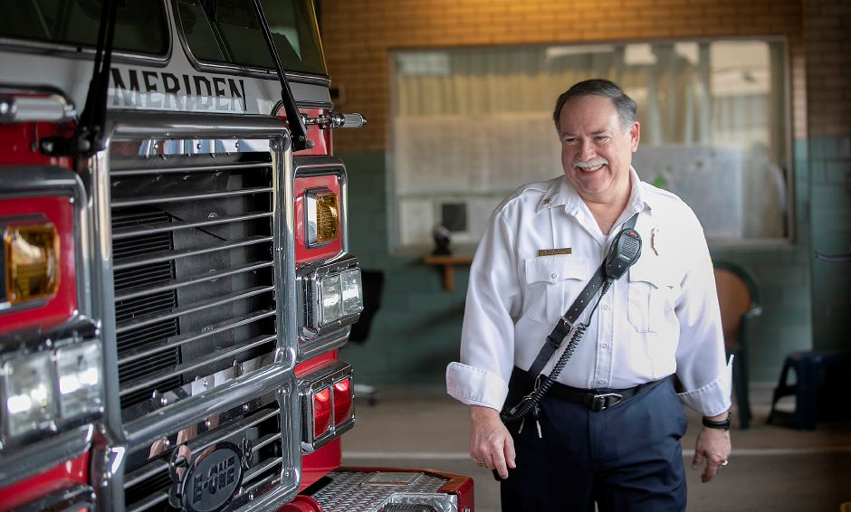 Assistant Chief Russ Donovan walks next to Truck 1 during his last shift at the Pratt Street firehouse on Tuesday. Donovan is retiring after nearly 37 years of service to the city. As Assistant Chief, he was the Shift Commander for Group 1.