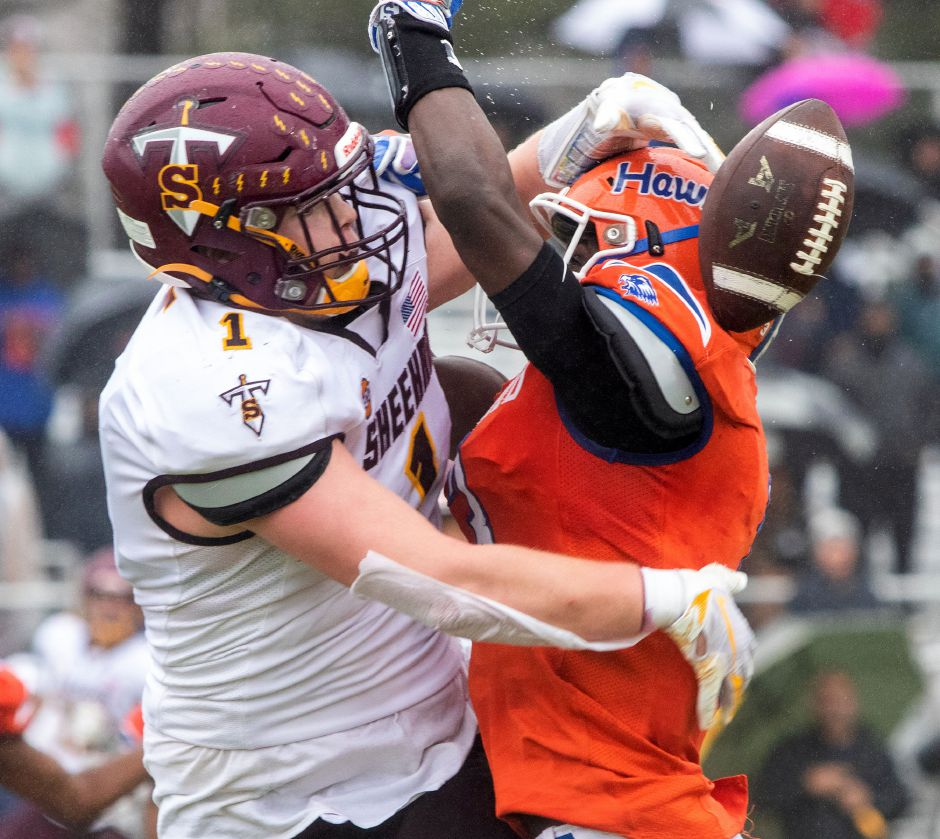 The ball pops free as Sheehan's Braedon McCarthy and Bloomfield's Anthony Simpson come together in the end zone during the first half of Saturday's Class S title game. Aaron Flaum, Record-Journal