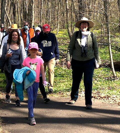 Mary Mushinsky along with Christine and Valentina Ouijano lead hikers on Quinnipiac Banton Trail