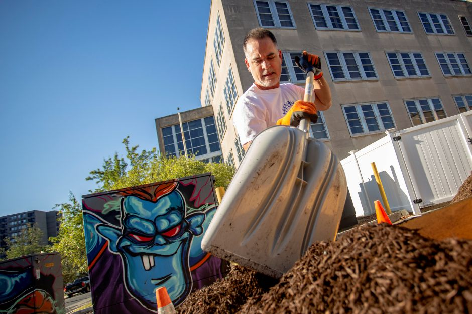 Mark Dullea, Record-Journal Art Director, shovels mulch at the Meriden Y during the United Way Day of Caring Sept. 17, 2019. | Richie Rathsack, Record-Journal