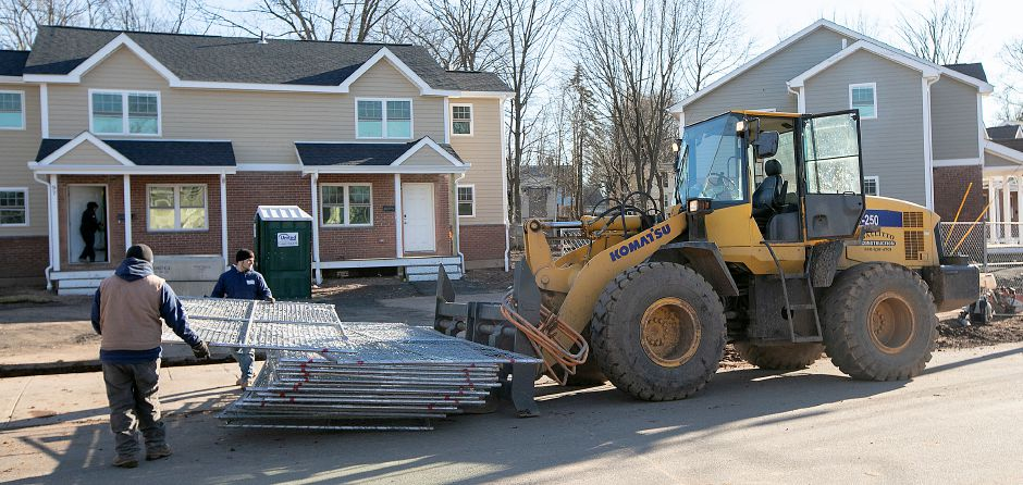 Crews working for Carabetta Inc. unload fencing on Wednesday while working on the Yale Acres public housing project in Meriden.