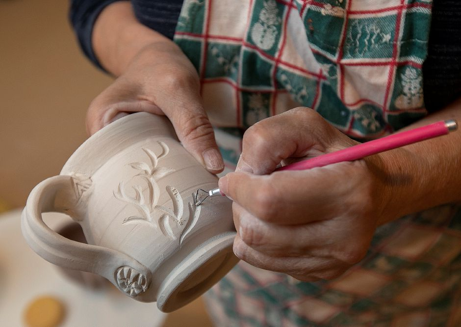 Judy Gerarde, of Southington, carves a design on a mug during a pottery class at Southington Community Cultural Arts, 93 Main St., Tues., June 25, 2019. Southington Community Cultural Arts will offer classes for kids over the summer along with continuing pottery and weaving opportunities for adults. Dave Zajac, Record-Journal