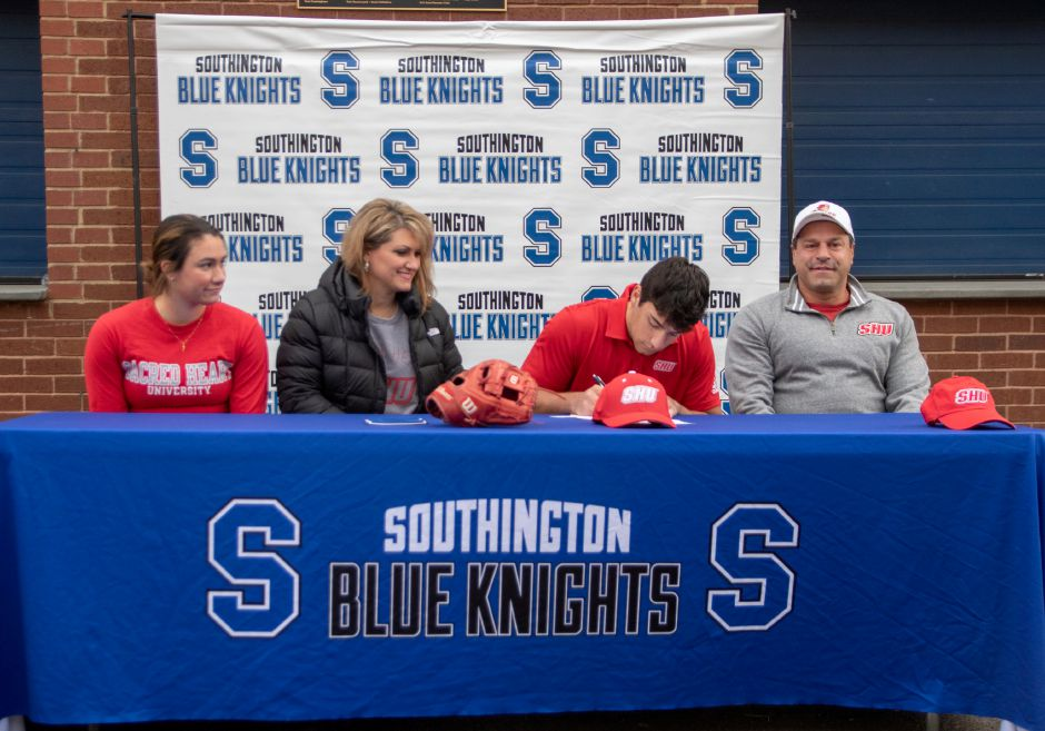 Southington's Dante Damore signs a National Letter of Intent to play baseball at Sacred Heart University. He was joined at the ceremony his sister Bianca, mother Maria and father Antonio. Aaron Flaum, Record-Journal