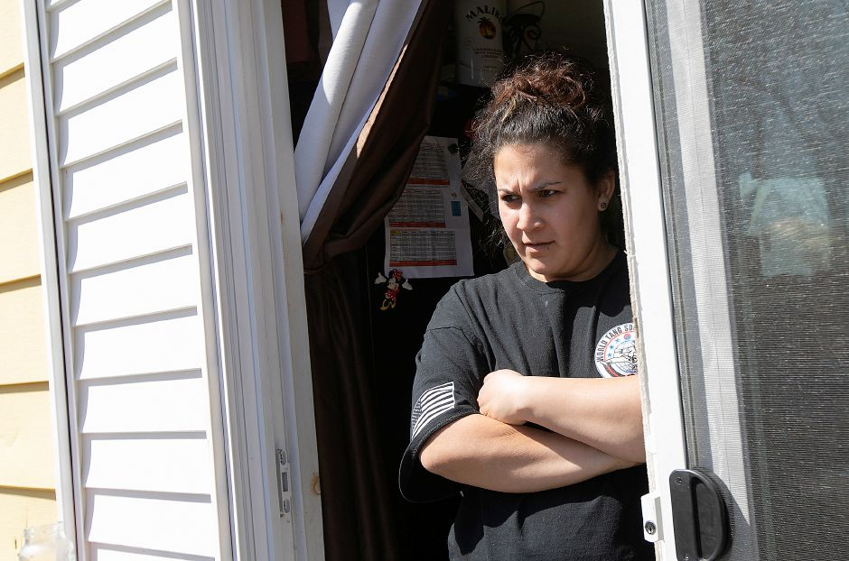 Martiqa Serrano Caban  talks Wednesday at her Gale Avenue residence in Meriden. Serrano Caban and other neighbors have concerns over an approved retail development on Broad Street. Dave Zajac, Record-Journal