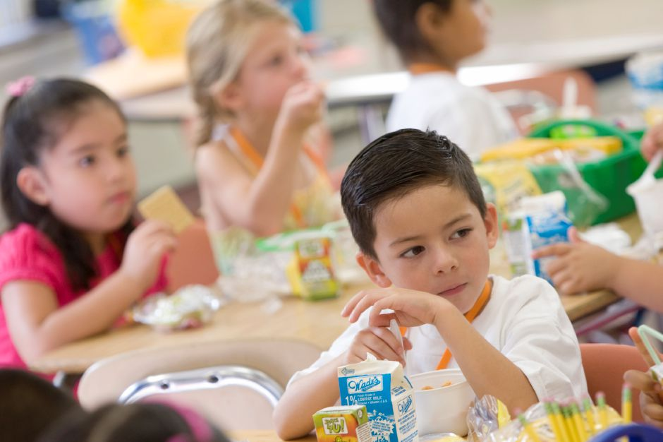 Julian Jimenez, 5, of Meriden, eats breakfast with his classmates during the first day of extended-day kindergarten at Roger Sherman Elementary School in Meriden, Wednesday, August 27, 2014. Students attend the school for an additional 100 minutes per day, using the extra time for more hands-on enrichment activities. | Dave Zajac / Record-Journal