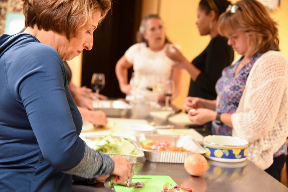 Carrie Marquardt, health and wellness director, chops vegetables during the paleo-cooking class.