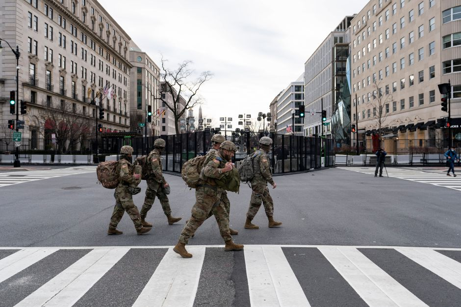 U.S. Army National Guard soldiers walk along K Street near Black Lives Matter Plaza, Tuesday, Jan. 19, 2021, in Washington. (AP Photo/Alex Brandon)