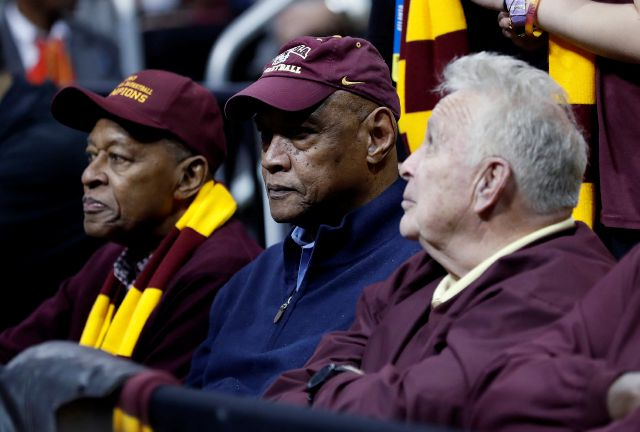 FILE - In this March 22, 2018, file photo, Loyola Chicago team members from 1963, Jerry Harkness, Les Hunter and John Egan, from left, watch the second half of a regional semifinal NCAA college basketball tournament game between Loyola and Nevada in Atlanta. Hunter, a star on Loyola Chicago