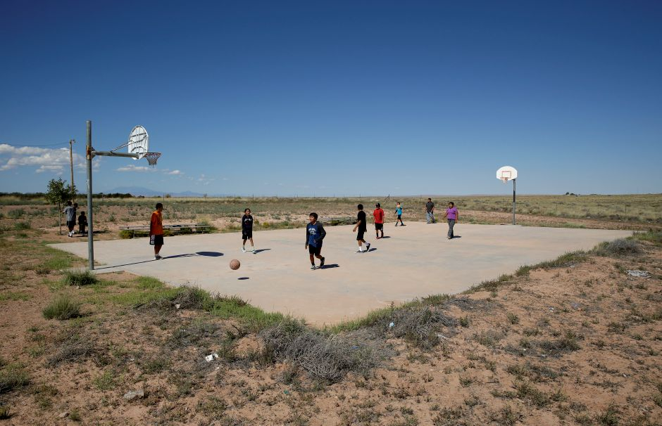 Students play basketball at Little Singer Community School in Birdsprings, Ariz., on the Navajo Nation. Basketball is woven in the fabric of Native American life. Now, during a global pandemic, the balls have all but stopped bouncing, as Native Americans have been hit hard by the coronavirus outbreak. John Locher, Associated Pressr