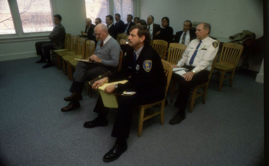 RJ file photo - Wallingford Traffic Maintenance Officer Richard Doll, Deputy Police Chief Darrell York and representatives from Amtrak, Conrail and the state DOT gather at Wallingford Town hall for a meeting Jan. 9, 1990 with Mayor William W. Dickinson Jr.