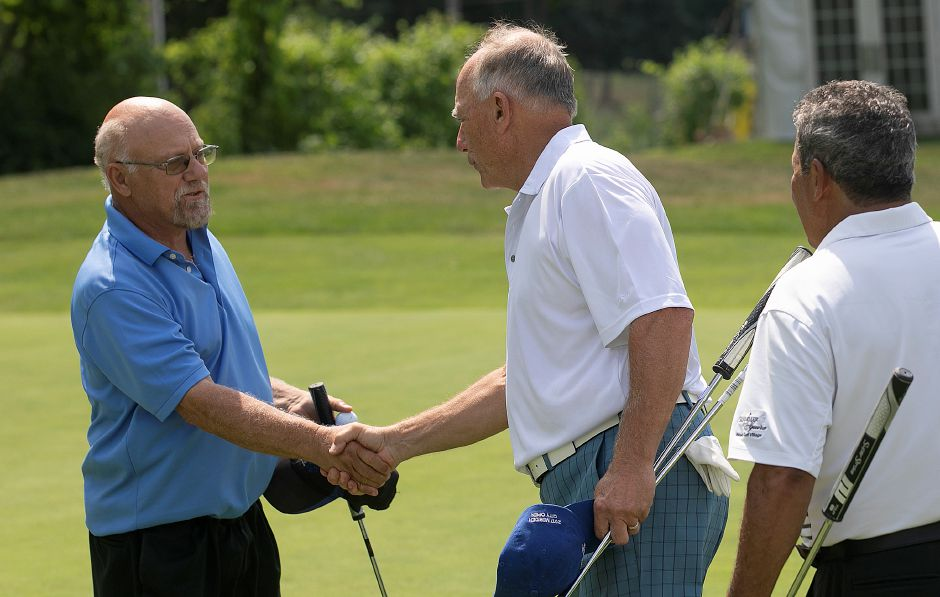 Kevin Grobsky, of Meriden, left, shakes hands with Les Zimmerman, of Meriden next to Jose Diaz, of Florida, after the first round of the Meriden Golf Senior Championship at Hunter Golf Club in Meriden, Wed., Aug. 7, 2019. Zimmerman, a six-time Meriden Senior champion and 12-time Meriden Open champ, shot a career-low 67. Grobsky carded a 69 that included four birdies. Dave Zajac, Record-Journal