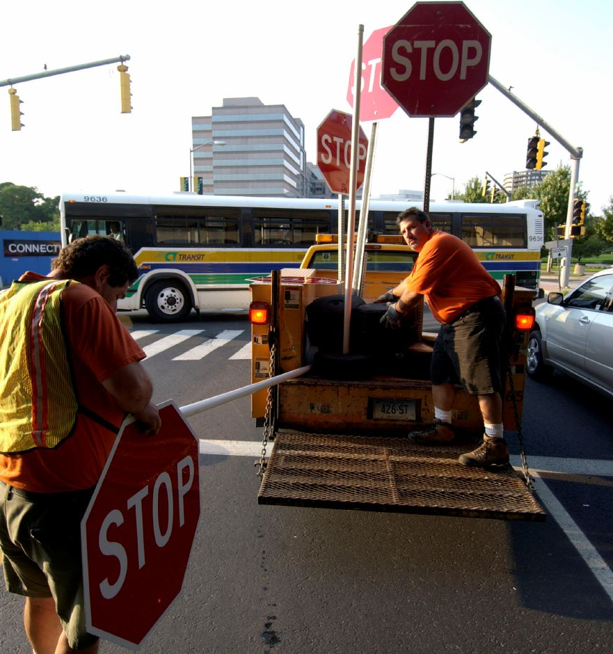 City of Stamford Conn. Department of Traffic workers prepare temporary stop signs Thursday, Aug. 14, 2003, traffic signals are out because of power outages Electric power outages shut down services in the North East Thursday. (AP Photo/Douglas Healey).