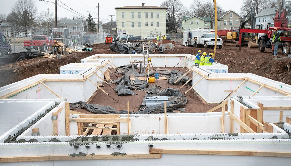 Crews pour cement into insulated concrete forms while working on the foundation of Hanover Place Veterans Housing on Hanover Street in Meriden, Mon., Jan. 13, 2020. Dave Zajac, Record-Journal