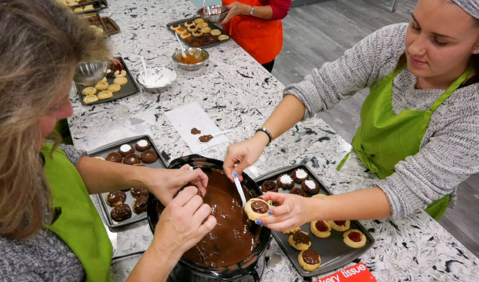 Participants decorate about five dozen freshly made cookies to take home during a Holiday Cookie Creation class at Foodology Cooking School in Plantsville, on Wednesday, Dec. 18, 2019. | Bailey Wright, Record-Journal