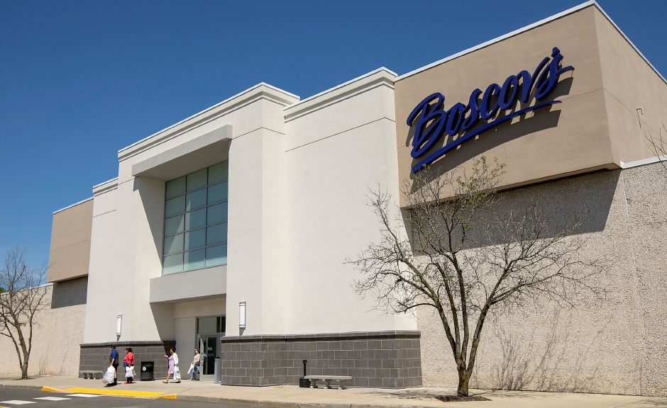 Customers exit the store after shopping at Boscov