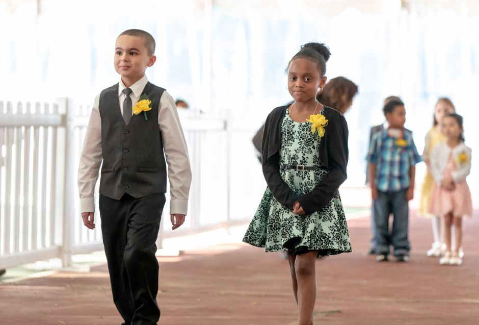 Aubrey Turner, 8, right, and Kayden Rodriguez, 8, of Israel Putnam Elementary School, are presented to the crowd at the crowning ceremony for Miss Daffodil on April 24, 2019. Rodriguez will be the escort for Scarlett Gibbs, who was crowned to head the Meriden Daffodil Festival Parade on April 27. | Devin Leith-Yessian/Record-Journal