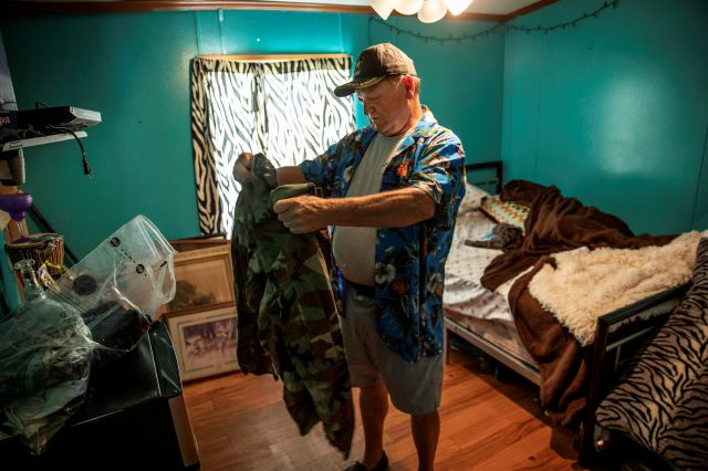 Fred VanDerzee, holds a jacket belonging to his son-in-law, Sgt. James Johnston, who was killed in Afghanistan in June, in the room he once shared with Fred