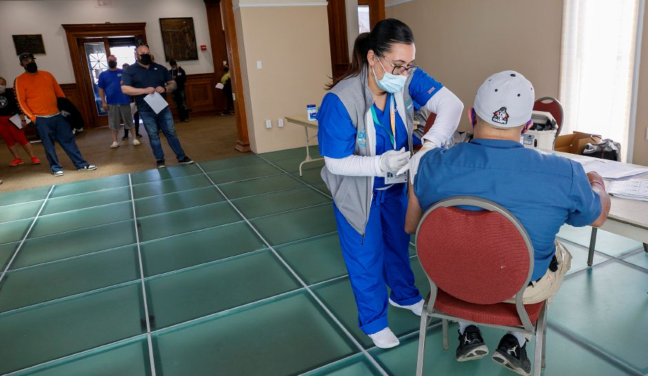 Griffin Hospital nurse Carrie Cotto administers COVID-19 vaccine to Reinaldo Vazquez, of Meriden, during a clinic at the Augusta Curtis Cultural Center on East Main Street in Meriden, Wed., Apr. 7, 2021. Dave Zajac, Record-Journal