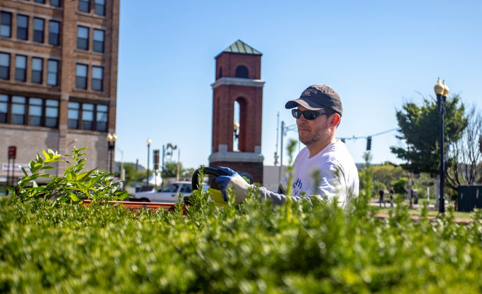 Dave Mazzaccaro, IT Director at the Record-Journal, trims bushes in front of the Meriden Y Arts Center along East Main Street Sept. 17, 2019 as part of a group from the Record-Journal taking part in the United Way Day of Caring. | Richie Rathsack, Record-Journal