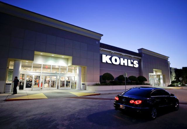 FILE - In this Aug. 22, 2017, file photo, a car drives by the entrance of a Kohl