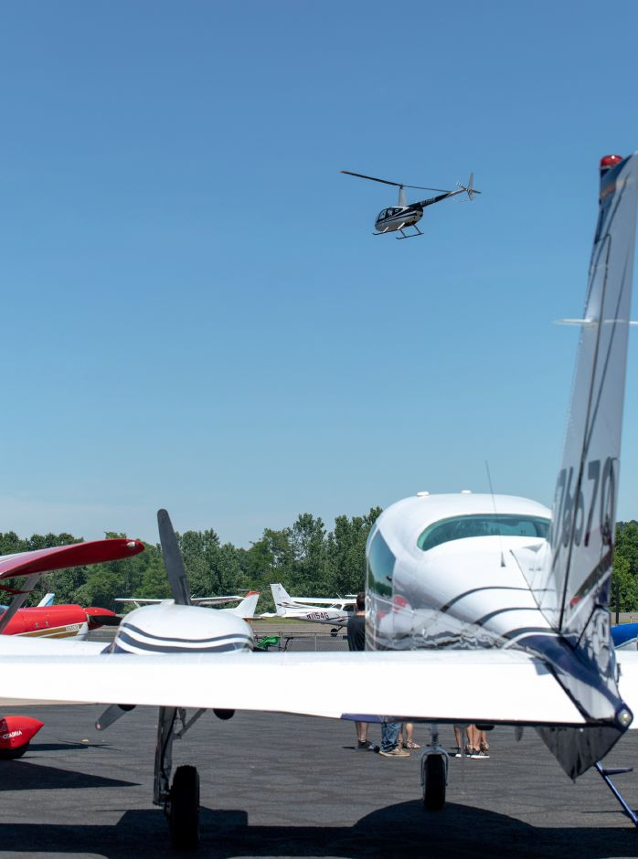 A helicopter flies over Robertson Airport June 8  during the Wings and Wheels car and air show.