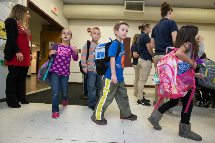Students at file into the cafeteria at Evarts C. Stevens Elementary School in Wallingford for a Backpack Safety Program provided by the occupational therapy students at Quinnipiac University Tuesday  Nov. 1, 2016 | Justin Weekes / For the Record-Journal