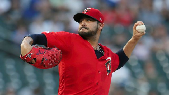 FIEL - In this Sept. 17, 2019, file photo, Minnesota Twins pitcher Martin Pérez throws against the Chicago White Sox in the first inning of a baseball game in Minneapolis. People familiar with the negotiations tell The Associated Press on Friday, Dec. 13, 2019, that the Boston Red Sox have agreed to one-year contracts with free agent left-hander Martin Pérez and shortstop José Peraza. The people spoke on the condition of anonymity because the deals had not yet been announced. (AP...