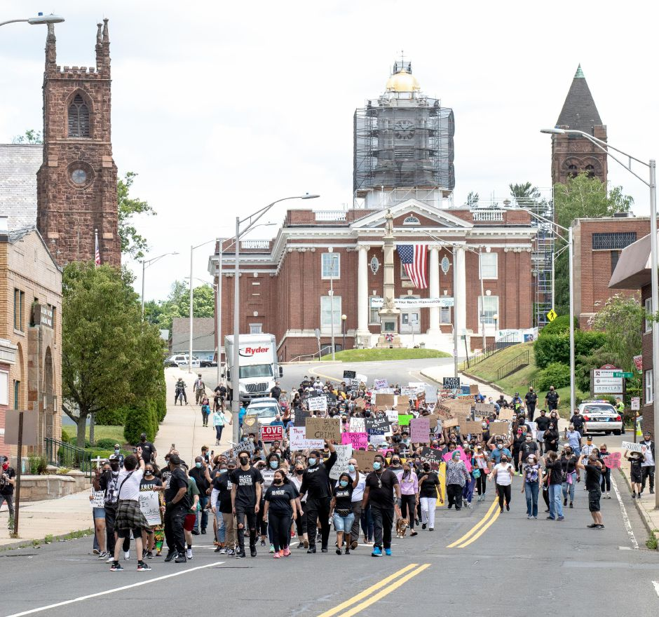 Black Lives Matter protesters marched from the Meriden City Hall to the Meriden Green on June 7, 2020. City and state elected officials and local clergy denounced racism and police discrimination and held a vigil for the unarmed African Americans killed by police. | Devin Leith-Yessian/Record-Journal