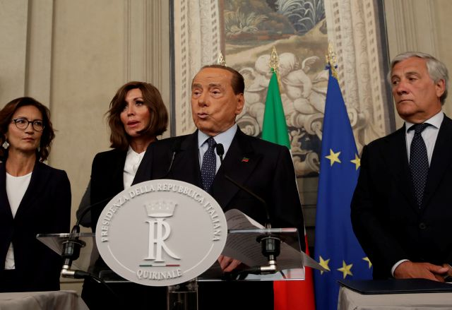 Forza Italia party leader Silvio Berlusconi talks to the press after meeting Italian President Sergio Mattarella, in Rome, Thursday, Aug. 22, 2019. President Sergio Mattarella continued receiving political leaders Thursday, to explore if a solid majority with staying power exists in Parliament for a new government that could win the required confidence vote. (AP Photo/Alessandra Tarantino)