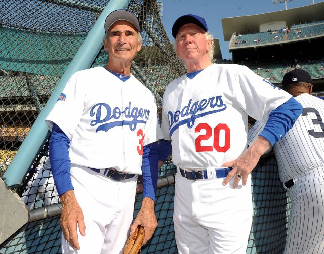 This June 8, 2013, photo shows Hall of Fame and former Los Angeles Dodgers pitcher Don Sutton, right, and Brooklyn Dodger pitcher Sandy Koufax, left, during the Old-Timers game prior to a baseball game between the Atlanta Braves and the Los Angeles Dodgers in Los Angeles. Sutton, a Hall of Fame pitcher who spent most of his career in a Los Angeles Dodgers