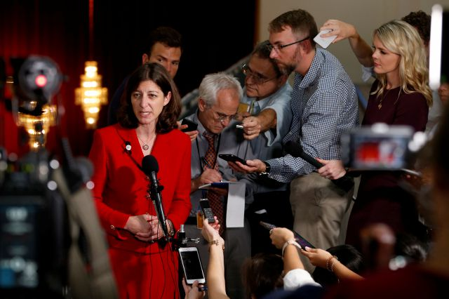 Rep. Elaine Luria, D-Va., left, answers reporters questions during a press conference prior to a town hall at a church in Virginia Beach, Va., Thursday, Oct. 3, 2019. Luria recently joined a group of other Congresswomen to call for the impeachment of President Trump. (AP Photo/Steve Helber)