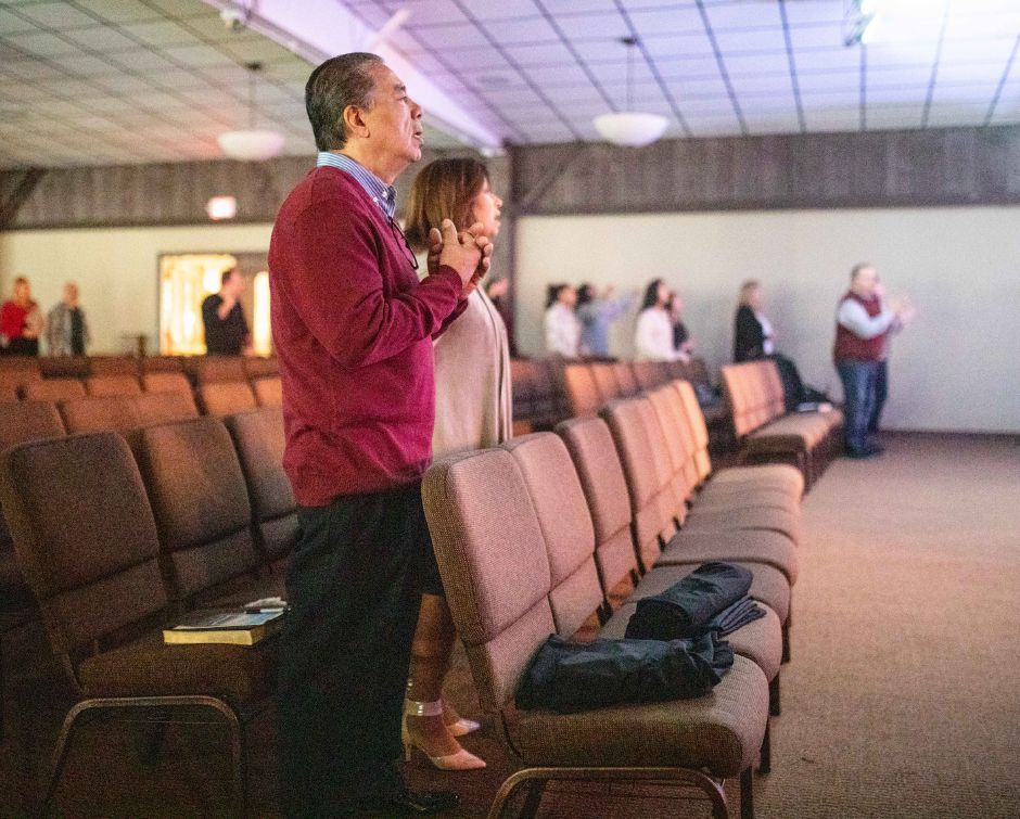 Members of New Life Church in Wallingford sing along to religious songs after the church asked its congregation to stay home on March 15, 2020. The Sunday service was instead live streamed with only staff present to help stanch the spread of the coronavirus. | Devin Leith-Yessian/Record-Journal