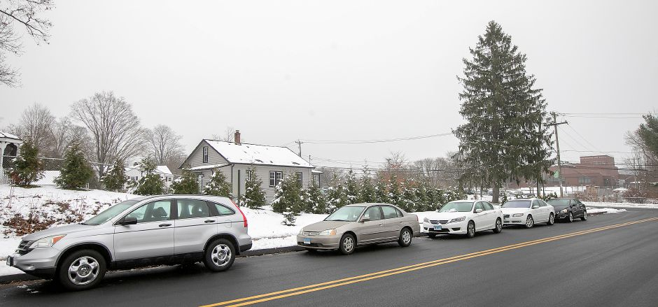Vehicles parked on Annelise Avenue near Southington High School, Fri., Dec. 13, 2019. School officials are hoping to use surplus funds to expand the Southington High School parking lot which would add nearly 100 spaces to the existing 400. Dave Zajac, Record-Journal