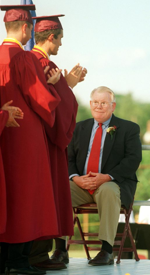 Retiring Sheehan principal Sean Meehan gets a standing ovation during graduation Tues., June 20, 2000.