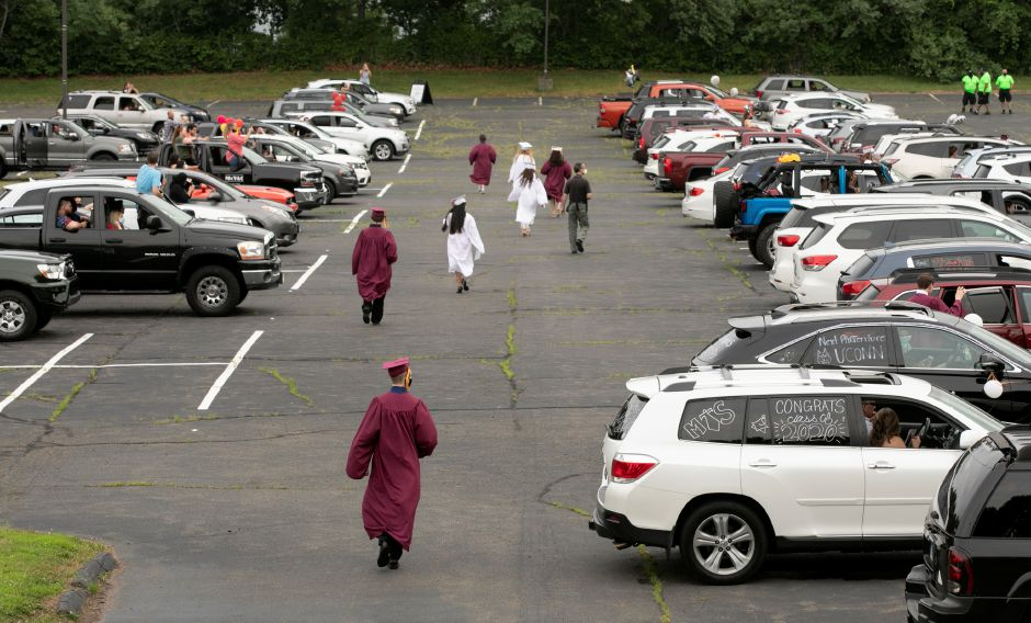 Sheehan High School graduates head to their vehicles after receiving their diplomas during graduation ceremonies at the Toyota Oakdale Theatre in Wallingford, Mon., Jul. 6, 2020. Dave Zajac, Record-Journal