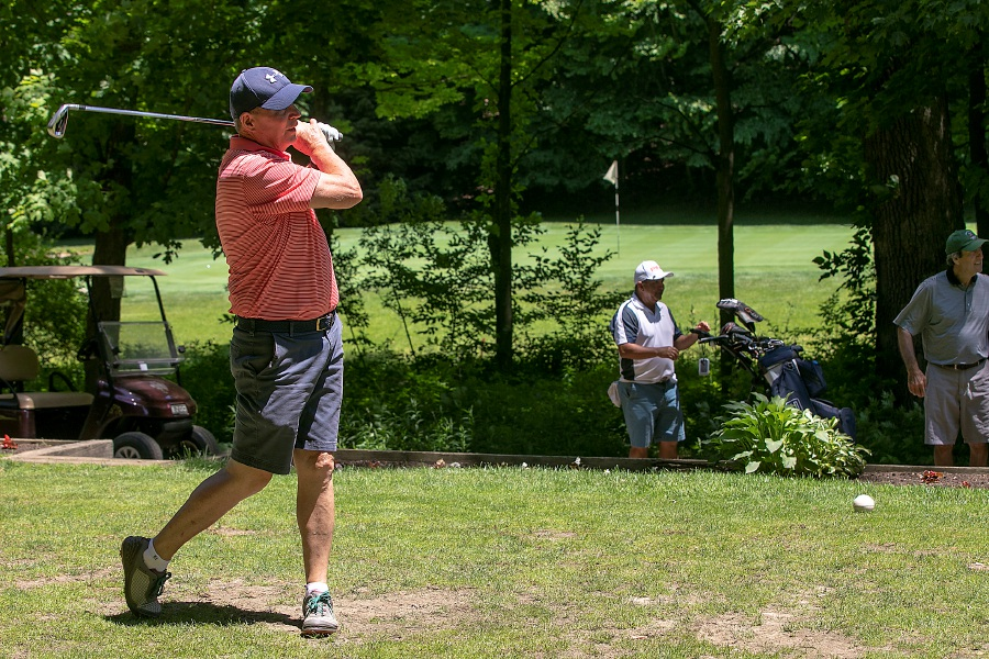 Mike Kennedy, of Meriden, watches his tee shot on Hole 16 while playing a round with Jose Calle, of Meriden, center, and Enrico Buccilli, of Wallingford, at Hunter Golf Course in Meriden. The golf course is one of many local options for Father's Day, Sunday, June 21. Kennedy has two children and four grandchildren.