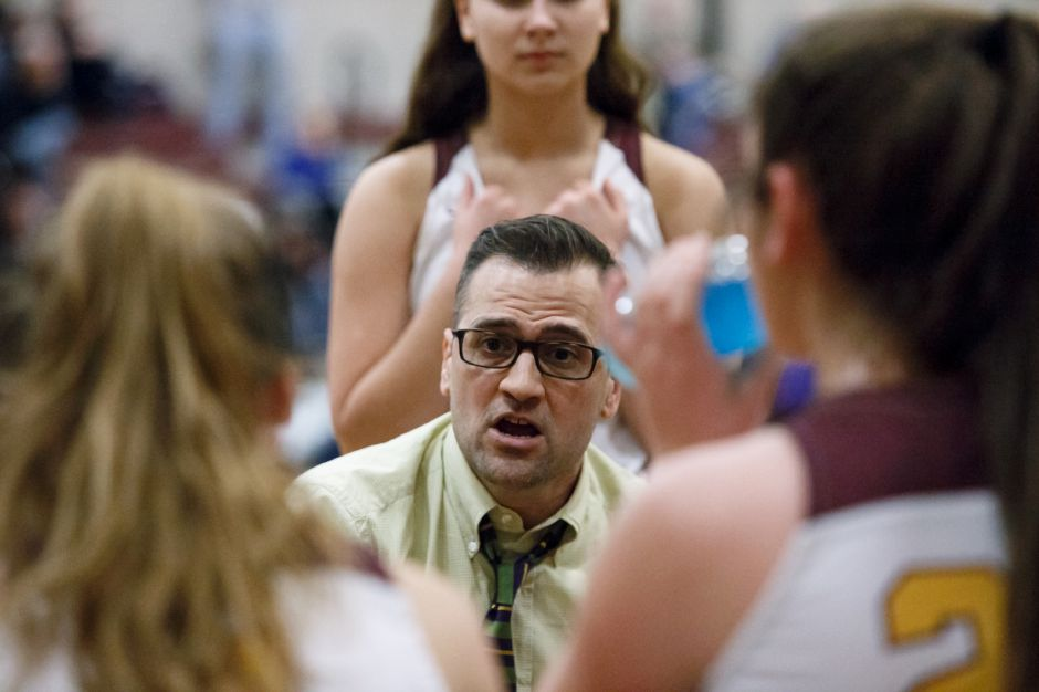 Sheehan girls basketball coach Mike Busillo chalked up career win No. 150 when his Titans defeated Jonathan Law 72-59 in a SCC Hammonasset game Tuesday night in Wallingford. | Justin Weekes / Special to the Record-Journal