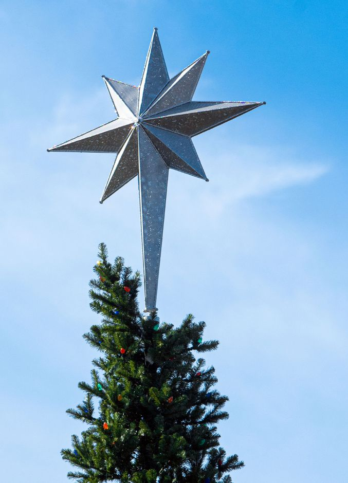 The star on top of the new outdoor artificial Christmas tree is on display at Johanna Manfreda Fishbein Park in downtown Wallingford. Aaron Flaum, Record-Journal