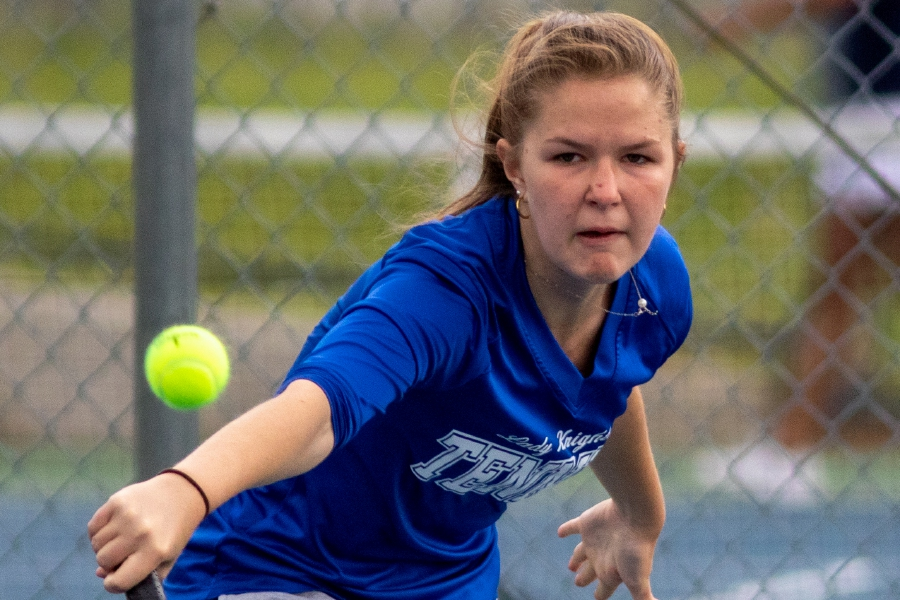 Southington's Riley Tindall makes a backhand return during her No. 1 singles match against Avon's Kerry Karlin at Southington High School on Monday. Avon won the match 6-1. Aaron Flaum, Record-Journal