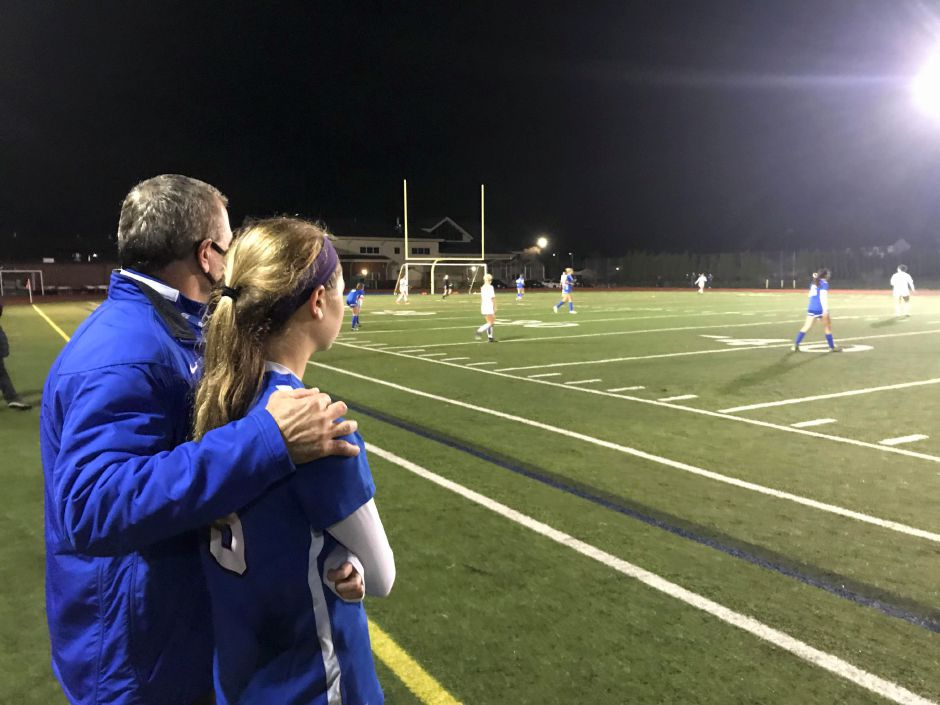 Southington girls soccer coach Mike Linehan and his daughter Brianna watch the final minutes of Southington's 6-0 victory over Lewis Mills in the CCC Region B championship game on Friday night at Fontana Field. Brianna Linehan is one of 11 seniors on a team that finished 14-0. Bryant Carpenter / Record-Journal