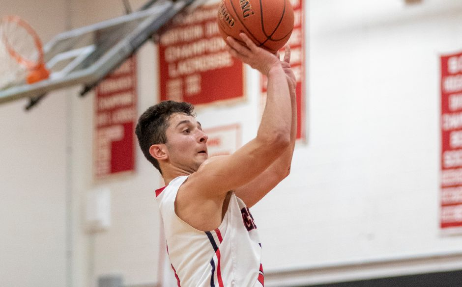 Alec Frione scored 16 points to lead the Cheshire boys basketball team past Southington 52-48 on Saturday night in Southington. | James Brandolini / Cheshire Herald