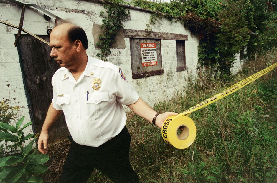 Wallingford Fire Marshal J. P. Micalizzi Jr. tapes off the perimeter of the Goldfeder factory in Wallingford Sept. 29, 1999. Connecticut State Department of Environmental Protection employees are going into the building which has lead in it.